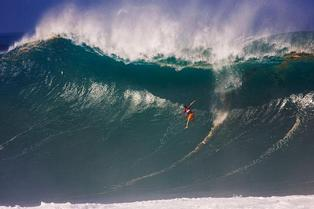 Mavericks Men Who Ride Mountains champion Daryl Virotsko from the U.S. surfs during the Quiksilver Eddie Aikau Big Wave Invitational contest at Waimea Bay, Hawaii, December 15, 2004. Virotsko took one of the most frightening wipeouts of the century, dropping down the face of a gigantic 40-foot wave. He suffered a knee injury from the fall and was forced to withdraw from the event. The Quiksilver In Memory of Eddie Aikau Big Wave Invitational is sanctioned by the Association of Surfing Professionals (ASP) and has an annual two-month waiting period .REUTERS/ASP/KAren Wilson/Handout