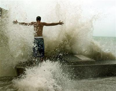 Joe McGee stands in the pounding surf at the Southern Most Point in Key West, Fla. Tuesday, Sept. 20, 2005, as Hurricane Rita neared the lower Florida Keys. (AP Photo/J. Pat Carter)