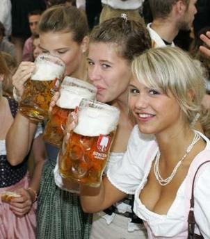 Girls in traditional Bavarian clothes toast with one-litre beer mugs during the opening day of the Oktoberfest in Munich September 17, 2005. Millions of beer drinkers from around the world will come to the Bavarian capital Munich for the world's biggest and most famous beer festival, the Oktoberfest. The 172st Oktoberfest lasts from September 17 until October 3. Some six million people are expected to visit 14 enormous tents, each capable of holding up to 10,000 people at a time, drinking some 5.5 million litres (1.453 million U.S. gallons) of beer in the process. REUTERS/Michaela Rehle