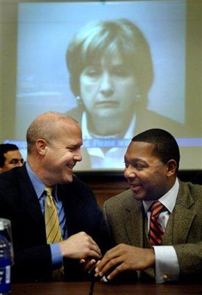 Louisiana Lt. Gov. Mitchell Landrieu, left, talks with Jazz great and New Orleans native Wynton Marsalis, right, before testifying with Louisiana Gov. Kathleen Blanco, in background via video teleconferencing, at the House Transportation and Infrastructure Committee joint hearing on rebuilding Louisiana, Tuesday, Oct. 18, 2005 in Washington. (AP Photo/Kevin Wolf)