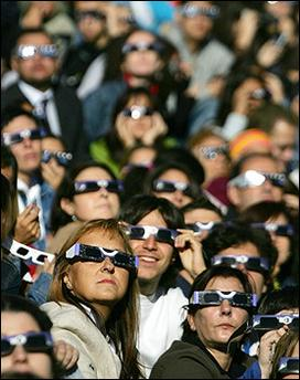 Mass viewing : People wear special glasses to watch the annular eclipse of the sun at the Planetarium in Madrid. (AFP/Philippe Desmazes)