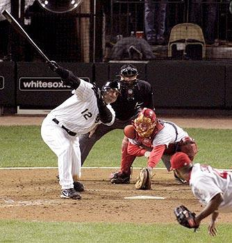 The White Sox's A.J. Pierzynski swings at a pitch from Los Angeles Angels pitcher Kelvim Escobar as catcher Jose Molina reaches to the ground for the ball during the bottom of the ninth inning of Game 2 of the ALCS at U.S. Cellular Field in Chicago, Wednesday, Oct. 12, 2005. Umpire Doug Eddings looks on from the plate. (Charles Rex Arbogast/Associated Press)