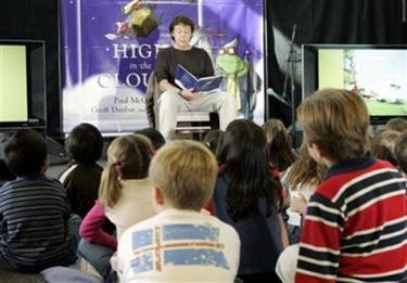 Singer and musician Paul McCartney reads passages from 'High in the Clouds,' a children's fantasy book he co-authored, before a group of students from Fairburn Elementary School, at a Borders bookstore in Los Angeles Thursday, Nov. 10, 2005. (AP Photo/Reed Saxon)