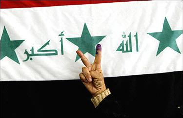 An Iraqi woman flashes the 'V' sign in front of an Iraqi flag after casting her vote at a polling station in central Baghdad. Iraqis streamed to the polls amid relative peace in a legislative vote many hope will heal a nation wracked by sectarian conflict and bring minority Sunnis back into the political process.(AFP/Ali al-Saadi)