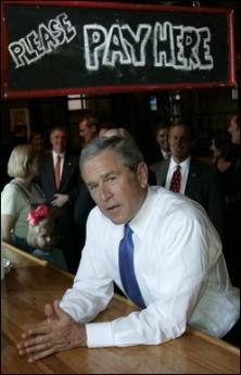 US President George W Bush, pictured waiting after ordering a cheese burger at a restaurant in Columbia, South Carolina, is to welcome Saudi Crown Prince Abdullah bin Abdul Aziz to his Texas ranch for talks expected to focus on the Middle East peace process and soaring oil prices(AFP/File/Brendan Smialowski)