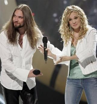 Bo Bice, left, and Carrie Underwood congratulate each other following their duet 'Up Where We Belong' during the 'American Idol' live finale in Los Angeles on Wednesday, May 25, 2005. (AP Photo/Kevork Djansezian)