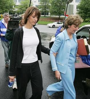 Runaway bride Jennifer Wilbanks, left, leaves the Gwinnett County courthouse with her attorney, Lydia Sartain, in Lawrenceville, Ga., Thursday, June 2, 2005. Wilbanks pleaded no contest Thursday to a felony charge and wept as she was sentenced to probation, community service and a fine. (AP Photo/Ric Feld)