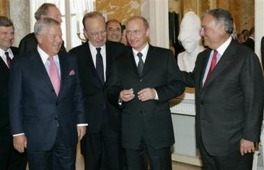 Russian President Vladimir Putin, second right, holds the diamond-encrusted 2005 Super Bowl ring belonging to New England Patriots owner Robert Kraft, left , as News Corp. Chairman Rupert Murdoch, second left, and Citigroup Chairman Sanford Weill look on during a meeting of American business executives at the 18th century Konstantin Palace outside St. Petersburg, Russia, Saturday, June 25, 2005. Kraft showed the ring to Putin _ who tried it on, put it in his pocket and left, said Russian news reports. It isn't clear yet if Kraft, whose business interests also include paper and packaging companies and venture capital investments, intended that Putin keep the ring. (AP Photo/Alexander Zemlianichenko)
