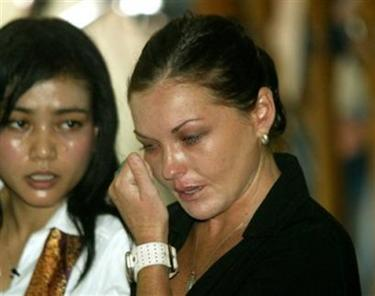 Schapelle Corby hears her verdict in a Bali courtroom as her interpreter looks on. (AP Photo/Dita Alangkara)
