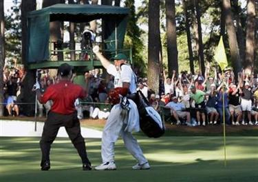Tiger Woods celebrates with his caddie Steve Williams after his chip-in birdie on 16th hole during the 2005 Masters at the Augusta National Golf Club in Augusta, Ga., Sunday, April 10, 2005. (AP Photo/Elise Amendola)