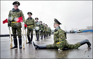 Getting ready : A Russian soldier streches during a rehearsal for the Victory Day military parade at the Khodinskoye airfield in Moscow. (AFP/Denis Sinyakov)