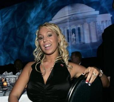 Porn star and former California gubernatorial candidate Mary Carey poses for photos as she attends the annual President's Dinner in Washington Tuesday, June 14, 2005. The event was sponsored by the National Republican Senatorial Committee and the National Republican Congressional Committee. (AP Photo/Gerald Herbert)