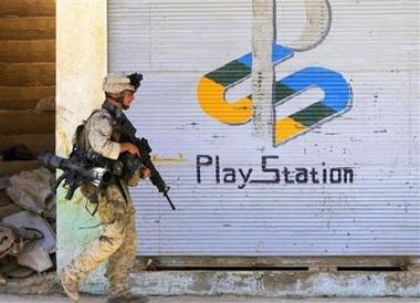 U.S. Marine Lance Cpl. Anthony Weber, of Columbus, Ohio, walks passed a shuttered storefront advertising the video game machine Play Station, during a foot patrol in Hit, 200 kilometers (125 miles) west of Baghdad, Iraq, Friday, July 1, 2005. U.S. Marines conducting Operation Sword, now in its fourth day, are encouraging people to come out of their homes after completing house to house searches earlier in the week. (AP Photo/Jacob Silberberg)