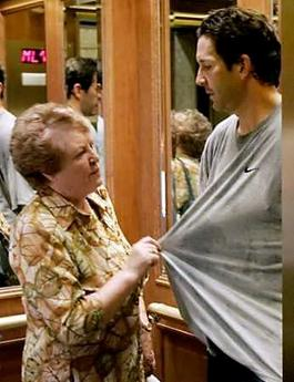 Mother of Detroit Red Wings' Brendan Shanahan (L) pulls at the NHL player's t-shirt while getting into an elevator following player voting on a new collective bargaining agreement with the League in a downtown Toronto hotel July 21, 2005. (J.P. Moczulski/Reuters)