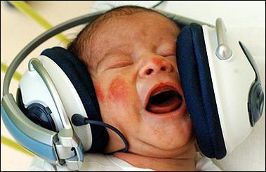 Rock on : One-day-old baby Tomas listens to music as a part of an experimental program that uses musical therapy to stimulate communication, adaptation and ease the stress after birth at the first private hospital in eastern Slovakia. (AFP/Joe Klamar)