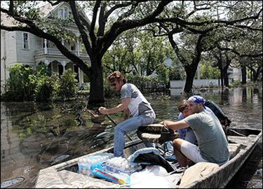 US actor Sean Penn paddles a boat after the motor failed to start as he made an attempt to rescue stranded people in New Orleans. Penn rescued several people from flooded houses in the city on September 4, before his boat sprang a leak.(AFP/File/Nicholas Kamm)