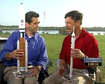 CNN American Morning anchor Miles O'Brien with an unidentified guest prior to the Space Shuttle launch