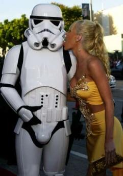 U.S. actress-model Katie Lohmann kisses a storm trooper character as she arrives for the premiere of 'Star Wars: Episode III - Revenge of the Sith' in Los Angeles' Westwood area May 12, 2005. REUTERS/Lee Celano