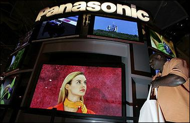 An attendee looks at a 103 inch Panasonic plasma television, the world's largest, on the opening day of the 2006 Consumer Electronics Show in Las Vegas, Nevada.(AFP/Getty Images/Justin Sullivan)