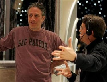 Jon Stewart, host of the 78th Academy Awards, left, talks to stage manager Gary Hood on the stage at the Kodak Theatre in Los Angeles, Thursday, March 2, 2006, during a set visit in advance of Sunday's Oscars. (AP Photo/Chris Carlson)