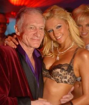 In this photo released by Playboy, Playboy founder Hugh Hefner, poses with Paris Hilton as he celebrates his 80th birthday at the Playboy Mansion in the Holmby Hills area of Los Angeles, Saturday night, April 8, 2006. (AP Photo/Playboy, James Trevenen)