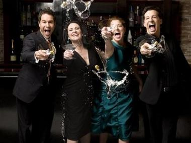 This undated photo, supplied by NBC, shows the cast of NBC's 'Will & Grace,' from left to right, Eric McCormack, Megan Mullally, Debra Messing and Sean Hayes, splashing their drinks after their series final episode, which airs on Thursday night, May 18, 2006. The comedy, which challenged TV's reluctance to feature gay characters and became an unexpected hit, is wrapping up its eight-season run.(AP Photo/NBC, George Lange)