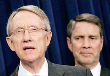 Senate Minority Leader Harry Reid (L), D-NV, flanked by Senate Majority Leader Bill Frist (R), R-TN, speaks about the Immigration Reform Bill that passed in the Senate in Washington, DC. The Senate approved the immigration legislation that will give most illegal immigrants the chance to become American citizens.(AFP/Getty Images/Mark Wilson)