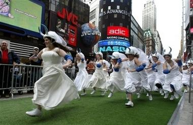 A group of soon-to-be brides race for a $25,000 dream wedding grand prize during the '2nd Annual Running of the Bridezillas' in Times Square, New York, Monday June 12, 2006. The event marked the third season for the WE television hit show 'Bridezillas'. (AP Photo/Bebeto Matthews)