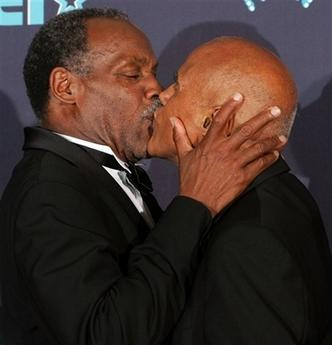 Presenter Danny Glover, left, kisses Harry Belafonte backstage after Belafonte received the BET humanitarian award during the 6th annual BET Awards on Tuesday, June 27, 2006, in Los Angeles. (AP Photo/Danny Moloshok)