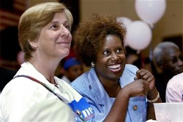 Congresswoman Cynthia McKinney, right, gathers with Cindy Sheehan Tuesday, July 18, 2006, at her campaign headquarters in DeKalb, Ga. (AP Photo/W.A. Harewood)