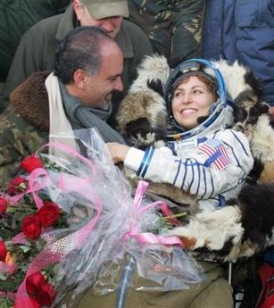 Space tourist Anousheh Ansari and her husband Hamid meet near the Souyz capsule after landing in northern Kazakhstan September 29, 2006. A Russian Soyuz capsule with Iranian-born space tourist Ansari on board bumped down safely in the Kazakh steppe at dawn on Friday. (Shamil Zhumatov/Reuters)