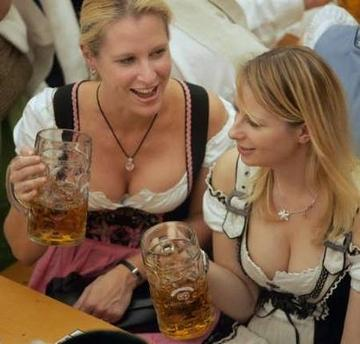 Women dressed in traditional Bavarian clothes enjoy their beer in a beer tent during the 173rd Oktoberfest, the biggest beer festival in the world, in Munich, October 2, 2006. Germans, in party mood after the World Cup and cheered by a pickup in the economy, have 18 days to consume millions of litres of beer and hundreds of thousands of sausages as the festival has been extended to include October 3 public holiday. REUTERS/Alexandra Beier (GERMANY)