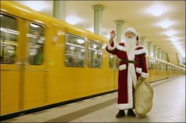 A man dressed as Father Christmas waves as he waits for an underground train in Berlin. Harrods has sacked a Father Christmas for his offensive remarks, the world-famous London department store has said.(AFP/DDP/Axel Schmidt)