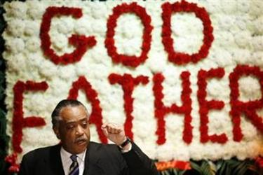 Al Sharpton addresses mourners during a public viewing of legendary singer James Brown's coffin at the Apollo Theater in New York December 28, 2006. (Lucas Jackson/Reuters)