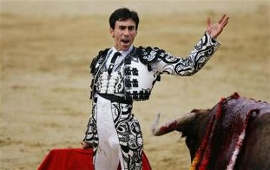 Spanish bullfighter Fernando Cruz while fighting a bull during San Isidro's bullfighting fair at Madrid's Las Ventas bullring, May 13, 2006. Cruz is recovering in hospital after the second bull of Tuesday's corrida caught him in the upper thigh, throwing him into the air, and gored him in the groin once he hit the ground. (Susana Vera/Reuters)