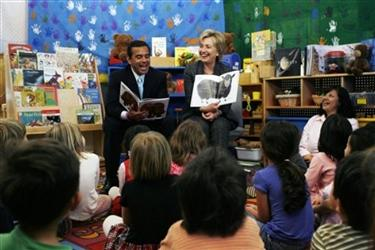Democratic presidential hopeful Sen. Hillary Rodham Clinton, D-N.Y., right, looks at Los Angeles Mayor Antonio Villaraigosa as they read from a book to pre-schoolers at UCLA's Kreiger Cebter in Los Angeles Wednesday, May 30, 2007. (AP Photo/Kevork Djansezian)