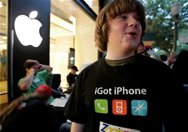 Patrick Scoble, 13, wears a homemade Apple iPhone shirt as he waits in front of an Apple store to be one of the first in line to purchase the new iPhone in Palo Alto, Calif., Thursday evening, June 28, 2007. The iPhone is planned to go on sale on Friday. (AP Photo/Paul Sakuma)