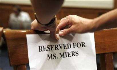 Chairs are reserved for former White House counsel Harriet Miers and her legal team at a hearing of the House Judiciary Committee about the controversy over the firing of nine U.S. attorneys last year on Capitol Hill in Washington July 12, 2007. (Kevin Lamarque/Reuters)