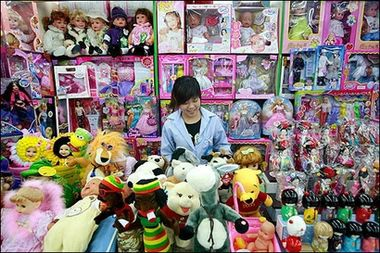 A woman selling Chinese made toys waits for customers at a shopping center in Beijing. A Fisher-Price recall of nearly one million Chinese-made toys, the latest in a series of similar scandals, is ratcheting up already high American resentment against the offshoring of jobs.(AFP/Teh Eng Koon)