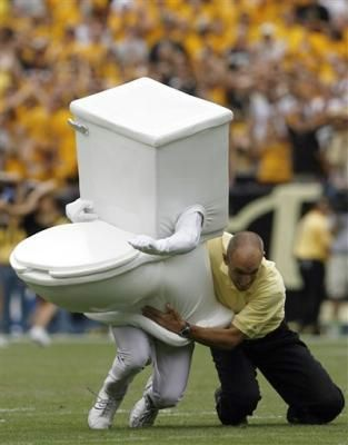 As part of a promotion by Denver Water to promote awareness of fixing running toilets, a running toilet is tackled by an unidentified security man during the fourth quarter of Colorado's 31-28 overtime victory over Colorado State in a football game in Denver on Saturday, Sept. 1, 2007. Denver Water is sponsoring several promotions around the city to promote water conservation. (AP Photo/David Zalubowski)