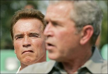 US President George W. Bush (R) speaks on the California wildfires while standing with California Governor Arnold Schwarzenegger (L) in Escondido, California. Bush toured fire-stricken California Thursday as the burned bodies of two more people were found among the smoldering rubble of infernos that have destroyed at least 1,400 homes and displaced 500,000 people.(AFP/Saul Loeb)