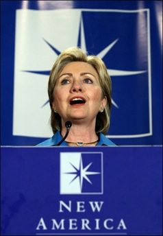 US Democratic Senator from New York and Presidential hopeful Hillary Rodham Clinton addresses the New America Foundation earlier this year, in Washington, DC. With the first showdown only days away, US presidential hopefuls will take a break for Christmas and let their television ads propagate some holiday cheer, but not exempt of political undertones. Clinton in her ad plays the role of a doting mother cutting wrapping paper and placing suggestive cards on Christmas gifts: 'Universal Health Care,' 'Energy Independence,' and, 'Bringing our Troops Home. '(AFP/File/Karen Bleier)<br />