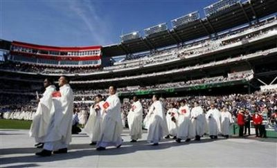Members of the Catholic Church enter the stadium prior to Pope Benedict XVI celebrating a Mass at Nationals Park in Washington April 17, 2008. (Jason Reed/Reuters)