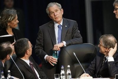 US President George W. Bush talks with Norwegian Prime Minister Jens Stoltenberg, second left, and Dutch Foreign Minister Maxime Verhagen, right, during a session with invitees, at the NATO Summit conference in Bucharest, Thursday April 3, 2008. The NATO allies agreed to put off a plan to put Ukraine and Georgia on track to join the alliance, but did invite Albania and Croatia to become members. (AP Photo/Gerald Herbert)