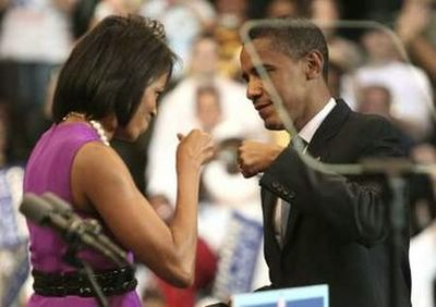 U.S. Democratic presidential candidate Senator Barack Obama (D-IL) bumps fists with his wife Michelle (L) before his speech at his South Dakota and Montana presidential primary election night rally in St. Paul, Minnesota June 3, 2008. REUTERS/Eric Miller (UNITED STATES) US PRESIDENTIAL ELECTION CAMPAIGN 2008 (USA)