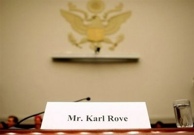 A chair for Karl Rove sits empty behind his name card during a House Judiciary Committee hearing on Capitol Hill in Washington DC. Rove, failed to show up for subpoenaed testimony before the House of Representatives Thursday in a probe of controversial firings of federal prosecutors, at Bush's request, sources said. (AFP/Getty Images/Mark Wilson)