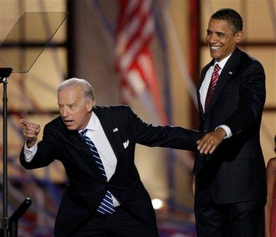 Democratic vice presidential nominee Sen. Joe Biden, D-Del.,points into the crowd as his running mate, Democratic presidential nominee, Sen. Barack Obama, D-Ill., waves after Obama's acceptance speech at the Democratic National Convention in Denver, Thursday, Aug. 28, 2008. (AP Photo/Ron Edmonds)