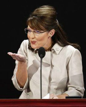 Republican vice presidential nominee Alaska Governor Sarah Palin blows a kiss to her baby during her speech at the 2008 Republican National Convention in St. Paul, Minnesota September 3, 2008. (Mike Segar/Reuters)