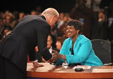 PBS journalist and debate moderator Gwen Ifill and Democratic vice presidential nominee, Sen. Joe Biden, D-Del., left, shake hands at the end of his vice presidential debate with Republican rival, Alaska Gov. Sarah Palin, (not shown) Thursday, Oct. 2, 2008, in St. Louis, Mo. (AP Photo/Don Emmert, Pool)