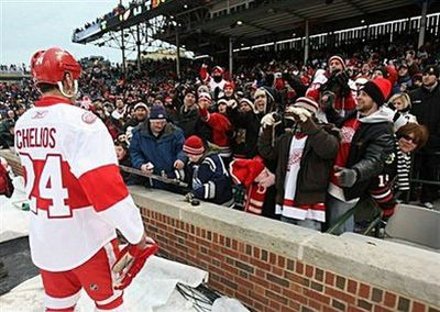 Chris Chelios of the Detroit Red Wings greets some fans after the Red Wings won 6-4 against the Chicago Blackhawks during the NHL Winter Classic at Wrigley Field in Chicago, Illinois. (AFP/Getty Images/Jonathan Daniel)